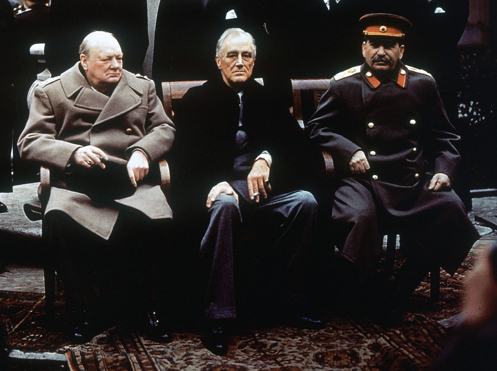 From-left-British-Prime-Minister-Winston-Churchill-U.S.-President-Franklin-Roosevelt-and-Soviet-Premier-Josef-Stalin-sit-on-the-patio-of-Livadia-Palace-Yalta-Crimea-in-this-February-4-1945-photo.-The-three-leaders-were-meet