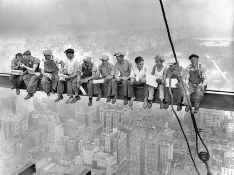 29 Sep 1932, Manhattan, New York, New York, USA --- Construction workers eat their lunches atop a steel beam 800 feet above ground, at the building site of the RCA Building in Rockefeller Center. --- Image by © Bettmann/CORBIS