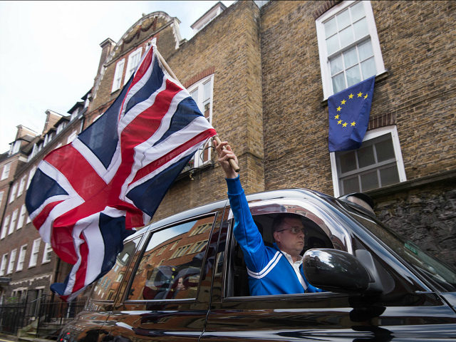 taxi-driver-waves-union-jack-britain-brexit-ap-640x480